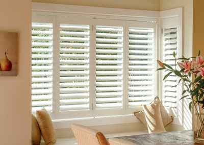 Hardwood Shutters - Bi-Folding in Bay Window