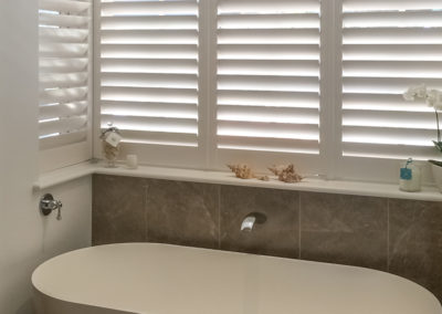 Hardwood Shutters - Coner Windows - Bathroom