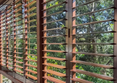 Aluminium Shutters - Bi-folds with Wood Graing Wrap 1