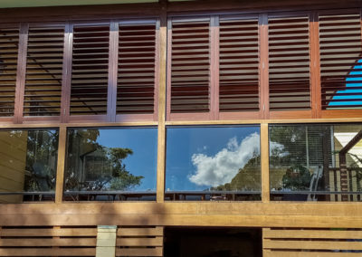Aluminium Shutters - Bi-folds with Wood Graing Wrap 2