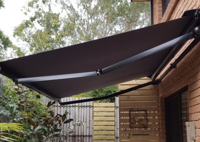 Folding-Arm-Awning-with-Semi-Cassette---Over-Deck